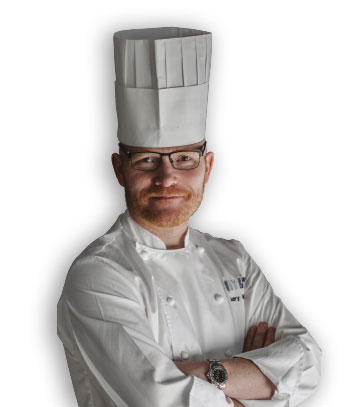 gary mclean wearing chef hat